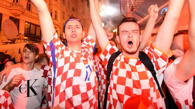 Croatia's fans celebrate victory against Russia.