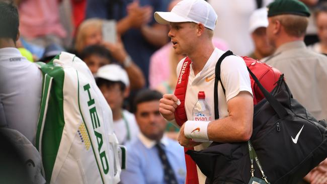 Britain's Kyle Edmund leaves the court after losing to Serbia's Novak Djokovic during their men's singles third round match on the sixth day of the 2018 Wimbledon Championships at The All England Lawn Tennis Club in Wimbledon, southwest London, on July 7, 2018. Djokovic won the match 4-6, 6-3, 6-2, 6-4. / AFP PHOTO / Glyn KIRK / RESTRICTED TO EDITORIAL USE