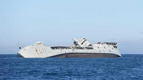 HMAS Tobruk is sunk in waters off Queensland.