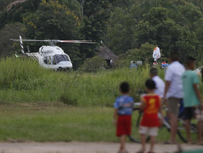 A helicopter believed to be carrying one of the boys rescued from the flooded cave lands in Chiang Rai.