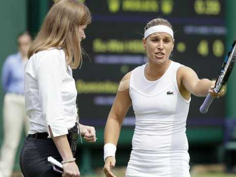 Dominika Cibulkova of Slovakia speaks to a match official after a line call during the women's singles match against Su-Wei Hsieh