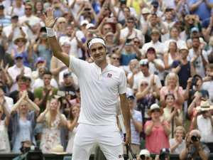 Federer breezes into fourth round
