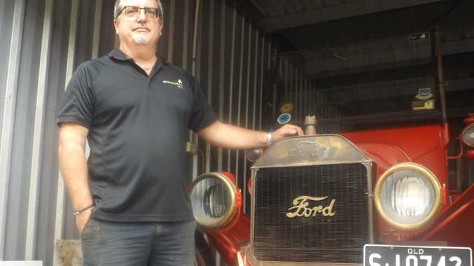 Craig Winter with the Model T Ford that served as a fire engine in 1915..