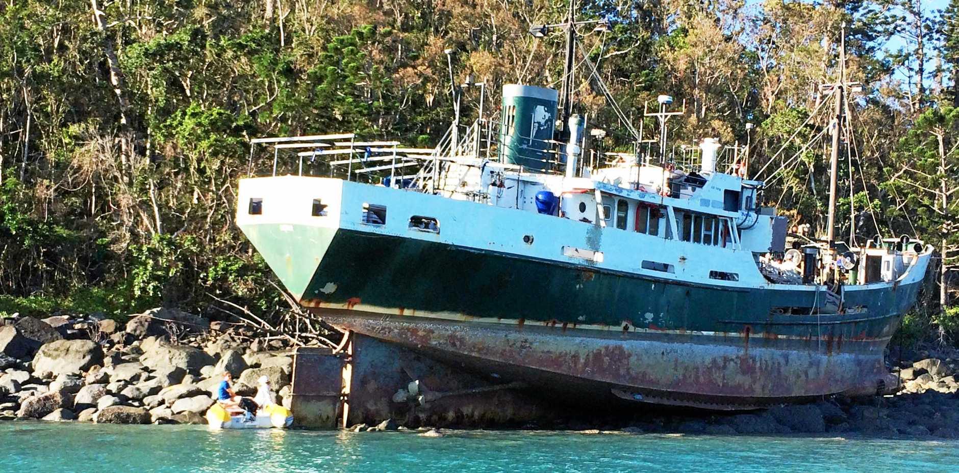 The former Australian Navy ship the MV Banks is still stuck on Whitsunday Island at Cid Harbour.