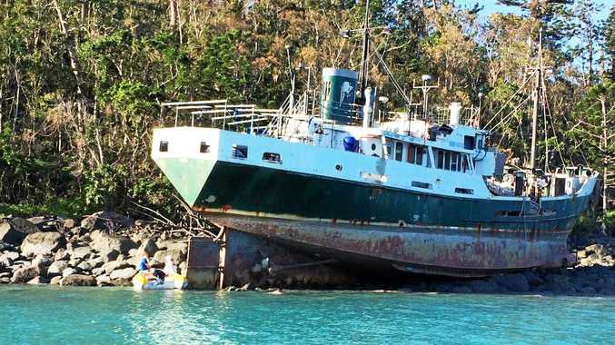 The former Australian Navy ship the MV Banks is still stuck on Whitsunday Island at Cid Harbour.