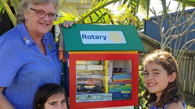 Walkerston Rotarian, Bente McDonald, with Ruby and Georgie Ruston who were the winner of the Little Library Competition.