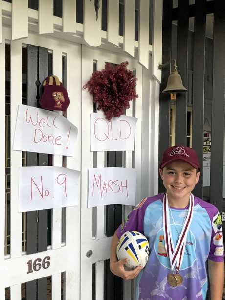 Braelan Marsh with the messages of congratulations this his family put on the front door to welcome him home.