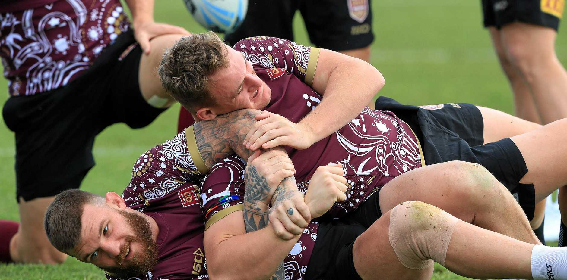 Josh McGuire wrestles with teammate Coen Hess at Queensland training.