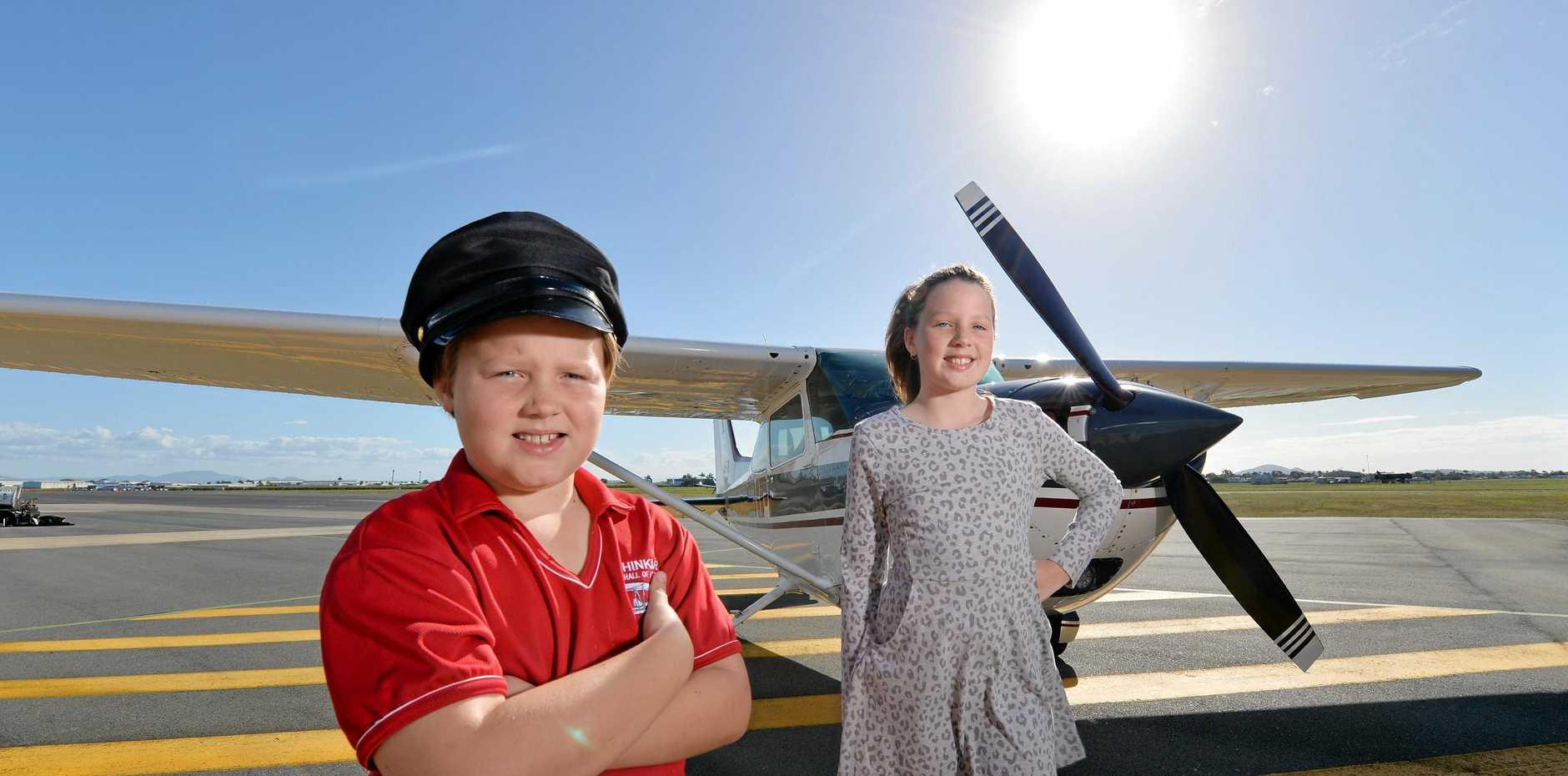 Mackay wants you Qantas. Aspiring pilot Max Lamb and his sister Emersen Lamb at Mackay Airport