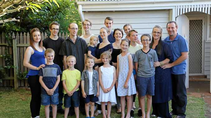LARGE FAMILY: The Bonell family are (back row, from left) Natalie, Karl, Jesse, Samuel, Katelyn, Claire, Cameron, Brooke, Sabrina, Timothy, parents Jeni and Ray Bonell and (front row, from left) Nate, Eric, Damian, Rachel, Eve and Brandon.