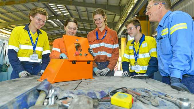 PRACTICAL LEARNING: Ainsley Cooper and Carl Tiplady takes students Nathanael Couch, Sophie Ure and Thayne Moon through some of the Boyne Smelter's daily operations during the Day In the Life program.