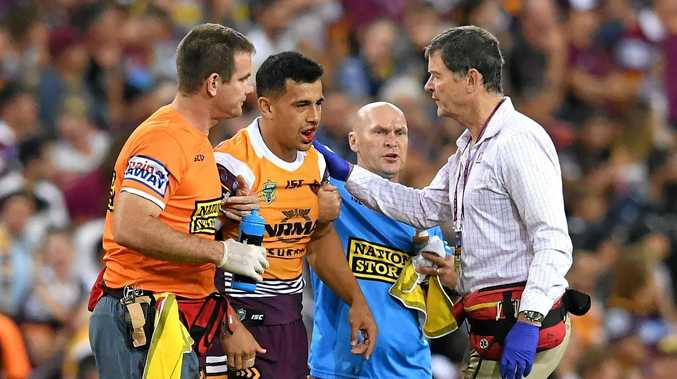 Jordan Kahu gets help from medical staff after breaking his jaw in round two. Picture: Darren England/AAP