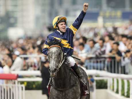 Tommy Berry salutes on Chautauqua after winning The Chairman's Sprint Prize race at Sha Tin Racecourse. Picture: Getty