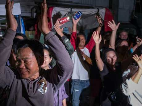 The whole world was engrossed in the plight of the boys, praying for them during the perilous rescue. Pictured, onlookers cheer as ambulances transport the last rescued schoolboys to Chiang Rai Prachanukroh Hospital. Picture: Linh Pham/Getty Images
