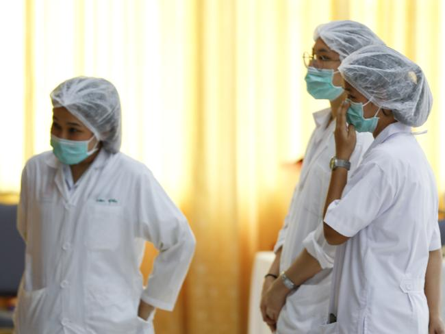 Medical staff at the hospital where the boys are receiving treatment. Picture: AP