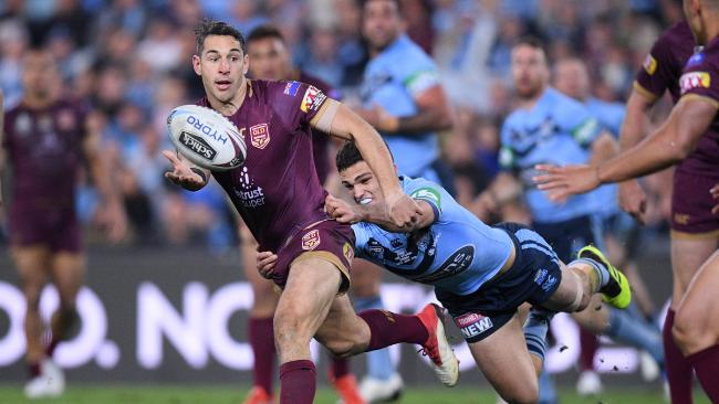 Billy Slater gets his pass away in game two of this year's series. (AAP Image/Dan Himbrechts)