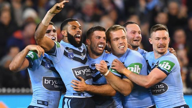 The Blues celebrate after James Tedesco late first-half try. (Quinn Rooney/Getty Images)