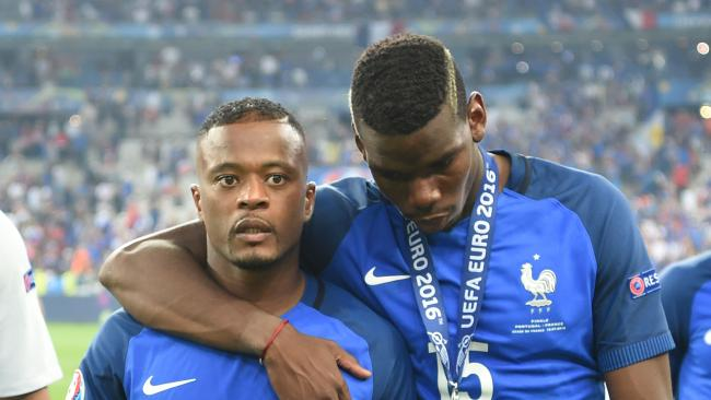 Patrice Evra (left) and Paul Pggba and their French teammates are through to the World Cup final.