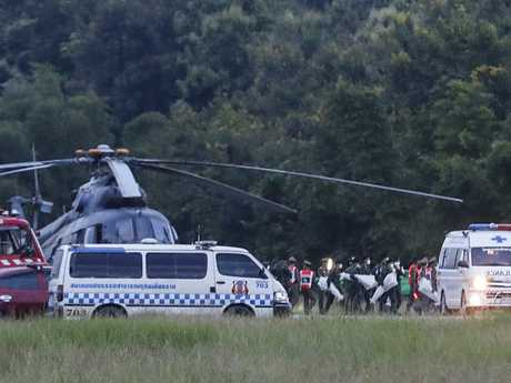 The last boys are evacuated and rushed to waiting ambulances. Picture: AP