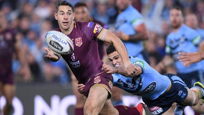 Billy Slater of the Maroons passes the ball in a tackle from Nathan Cleary of the Blues during Game 2 of the 2018 State of Origin series. Photo: AAP