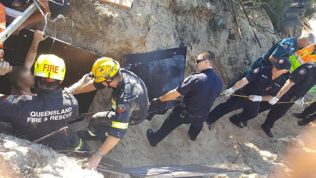 A 29-year-old man was freed after being trapped under mounds of sand for around five hours.