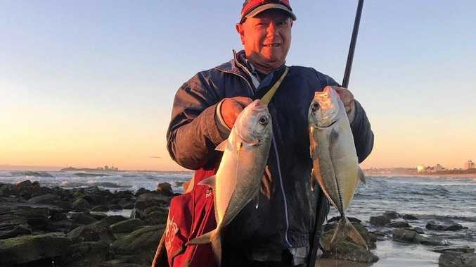 HOOKED: Craig Mullet with a couple of Trevally taken in the mouth of the Maroochy River.