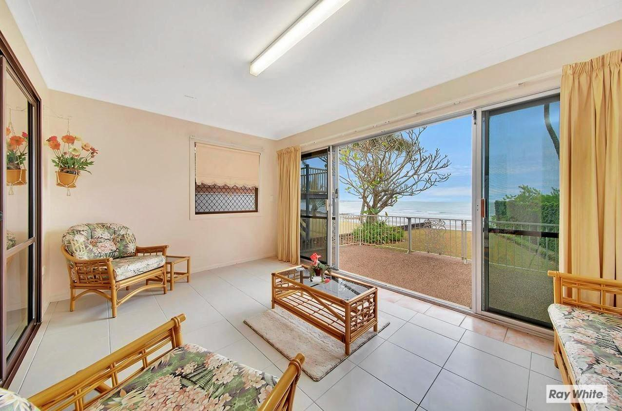 A gorgeous sun room looks out over Cooee Bay.