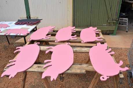 Piggy cut-outs for Baconfest.