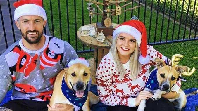 RUFF TIME: Lollie celebrating Christmas with her rescue family. (L-R) Jarrad, Ivy, Kayla and Lollie.