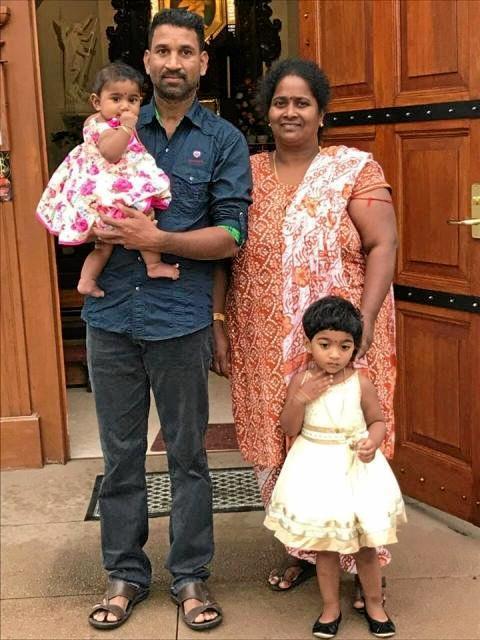 DEPORTATION THREAT: Nades holding Tharunicaa, 1, and Priya with Kopika, 3, want to return to Biloela.