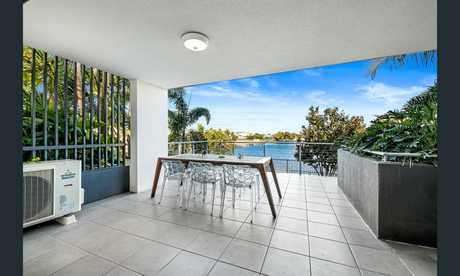 A Birtinya waterfront unit listed by Ray White Kawana and due to go under the hammer.