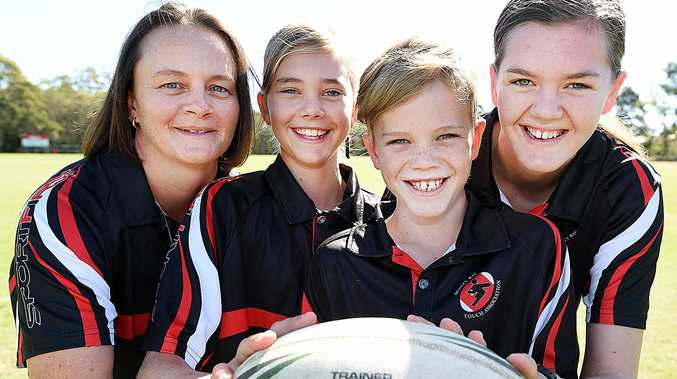 FOOTY FAMILY: Hervey Bay's Helen Hatchett with children Summer, 11, Sam, 9, and Charli, 15, Wilson. All four will participate at the Junior State Cup.