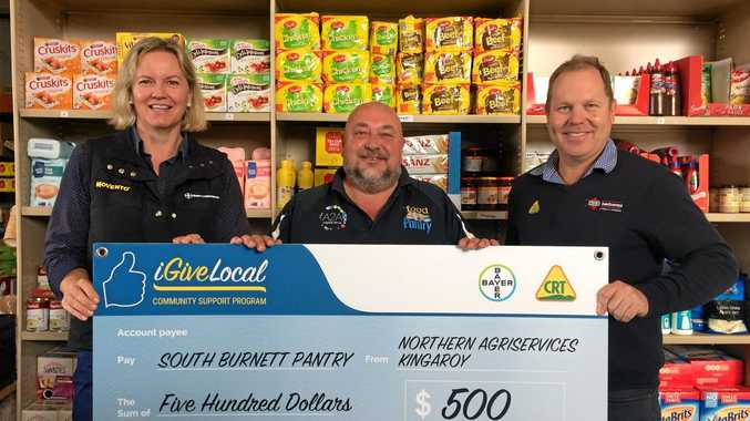 BIG CHEQUE: Lore Saupp-Saunders from Bayer Crop Science, Jim Bennet from the South Burnett Pantry and Mark Schmidt from Northern AgriServices.
