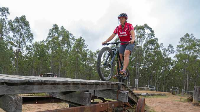ON TRACK: Simona De Silvestro gets in some mountain bike riding in Ipswich ahead of next weekend's Queensland Raceway event.