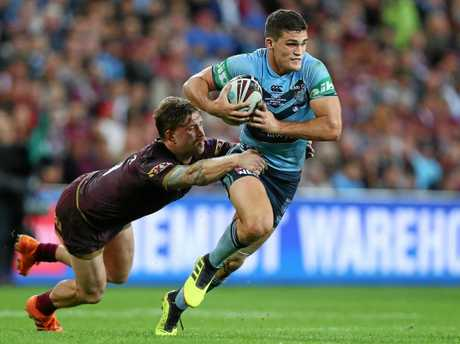 BRISBANE, AUSTRALIA - JULY 11:  Nathan Cleary of the Blues is tackled during game three of the State of Origin series between the Queensland Maroons and the New South Wales Blues at Suncorp Stadium on July 11, 2018 in Brisbane, Australia.  (Photo by Chris Hyde/Getty Images)