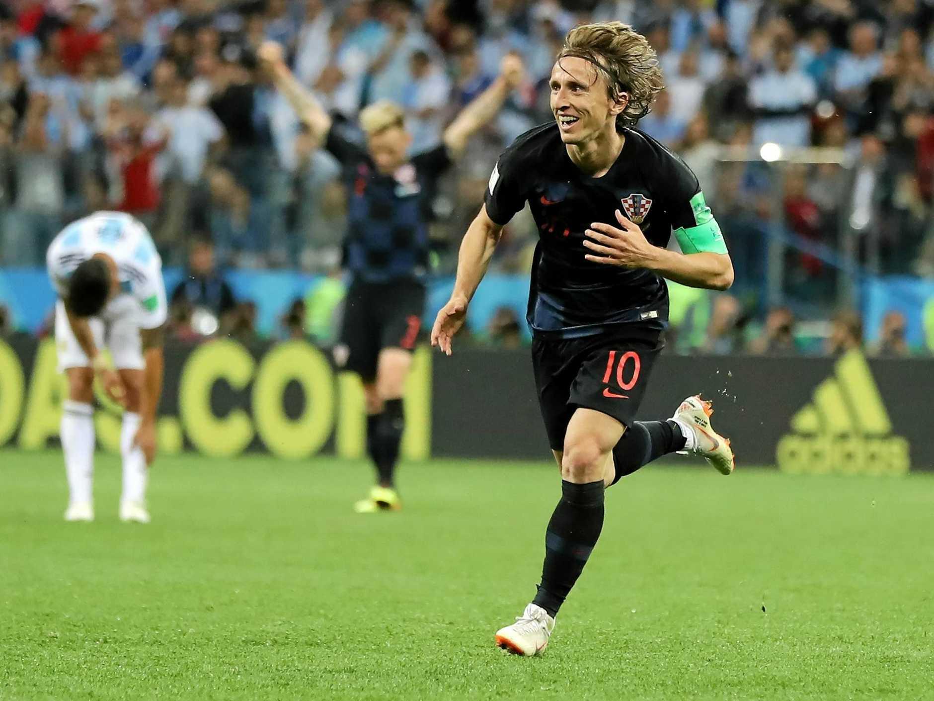 Why neutral fans should cheer for Croatia not France. Croatia's captain Luka Modric celebrates making Sunday's final.