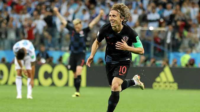 Why neutral fans should cheer for Croatia not France. Croatia's captain Luka Modric celebrates making Sunday's final.