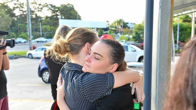 Natasha Reiss and Rachael Campbell comfort each other.