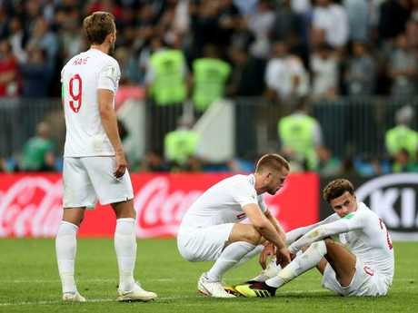 England captain Harry Kane, Eric Dier and Dele Alli, dejected after the loss. Picture: Clive Rose/Getty
