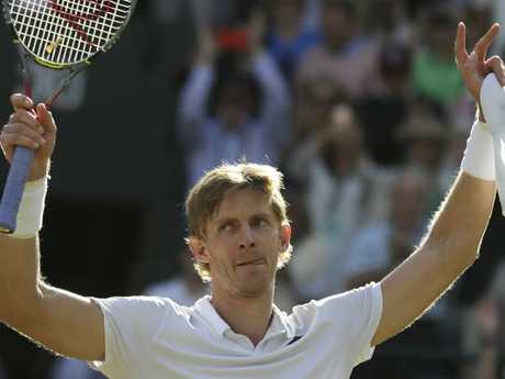 Kevin Anderson of South Africa celebrates winning his men's quarterfinals match against Switzerland's Roger Federer, at the Wimbledon Tennis Championships. Picture: AP Photo/Ben Curtis