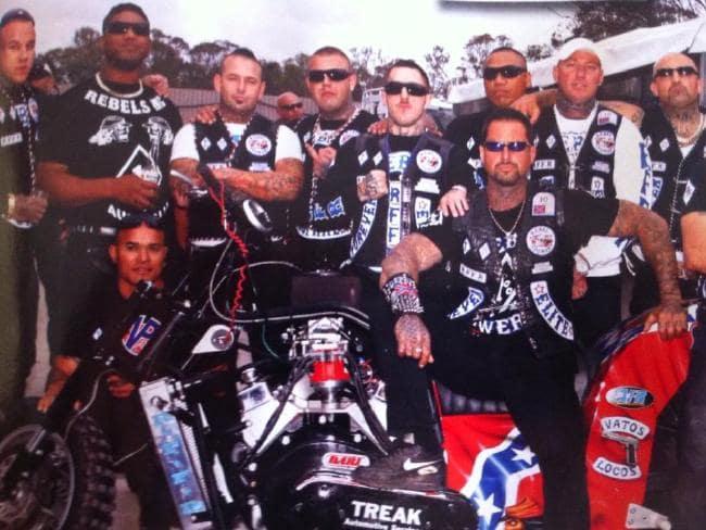 Rebels including Chris Rymer (left, white T-shirt, black vest), Matt King (front centre with black long-sleeves and Simon Rasic (at front on bike).