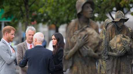 A sombre moment at the Famine Memorial. (Photo by Zak Hussein - Pool/Getty Images)