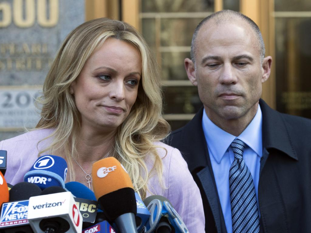 Stormy Daniels, left, stands with her lawyer Michael Avenatti as she speaks outside federal court, in New York. Picture: AP