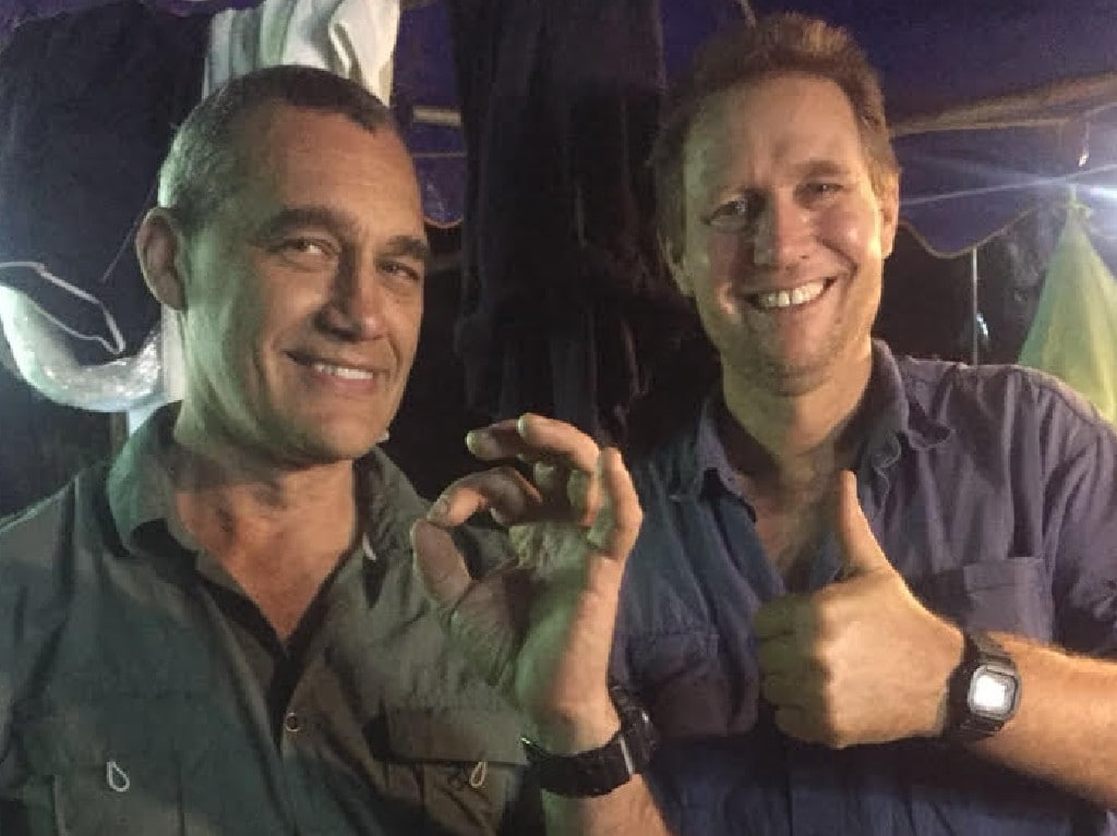 Craig Challen with dive partner Dr Richard Harris after they completed the mission. Picture: Office of the Minister for Foreign Affairs
