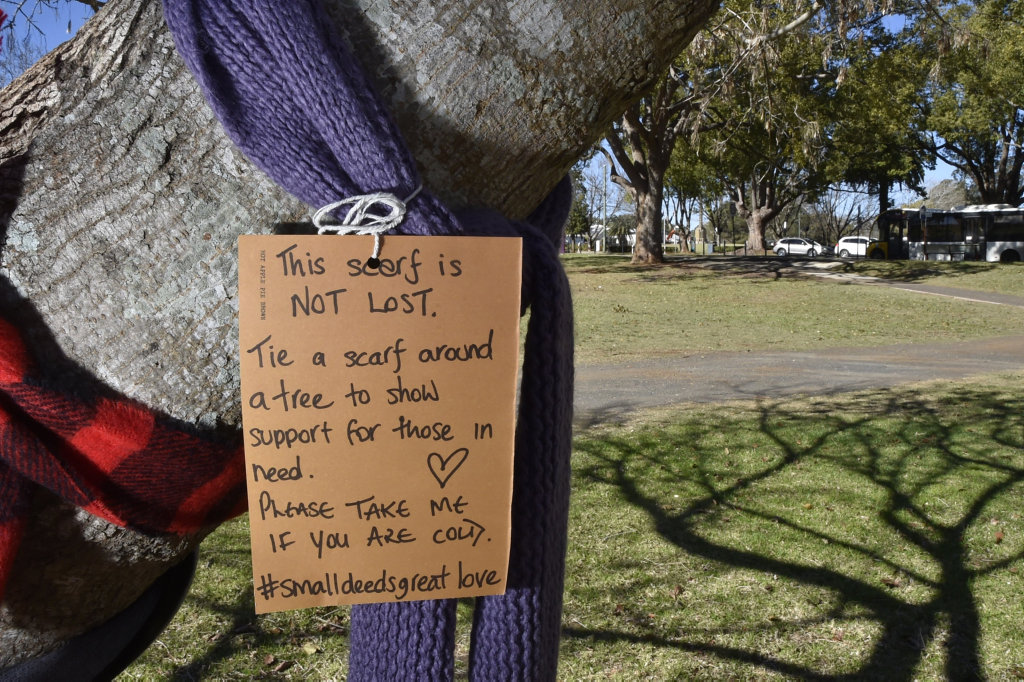 Cindy MacDonald is helping keep Toowoomba residents warm this winter by putting scarves, beanies and jackets on trees and inviting homeless, or just cold people to simply take them for free. July 2018