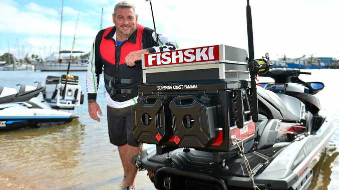 LAUGHING ALL THE WAY: Fishski co-inventor Rob Grace with a jetski fitted with his latest invention.