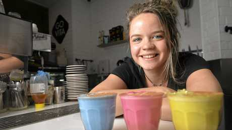 Emily Ganzenmuller with her colourful lattes at Go Vita Redbank Plaza.