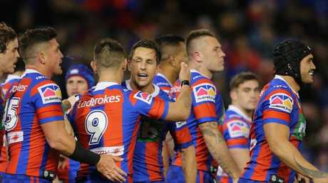 Mitchell Pearce, centre, is congratulated after scoring a try for the Knights against the Eels last Friday. Picture: Ashley Feder/Getty Images