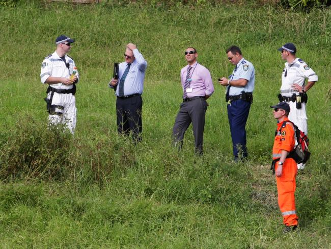 Police and SES volunteers searching a reserve in Berkeley after Darko Janceski was shot dead in the front garden of his house.