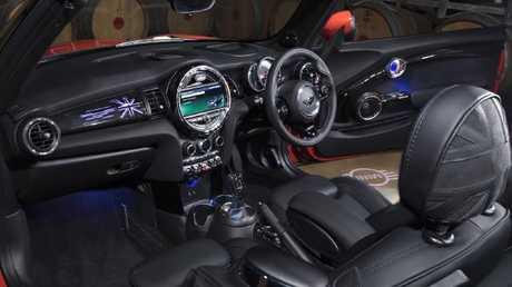 Make a statement: Mini cabin keeps large circular motif, adds custom dash cover